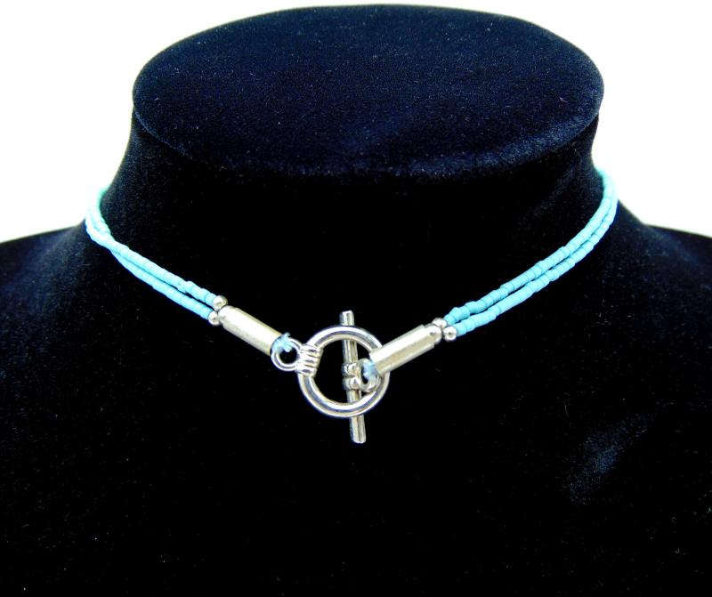 collier ethnique pierre naturelle turquoise et bracelet cristal rouge